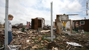 Residents look at the damage from a tornado that flattened Greensburg, Kansas, in May 2007.