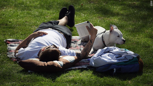 A man and his dog relax in the sunshine in Rembrandt Gardens, Little Venice on April 8, 2011 in London, England.