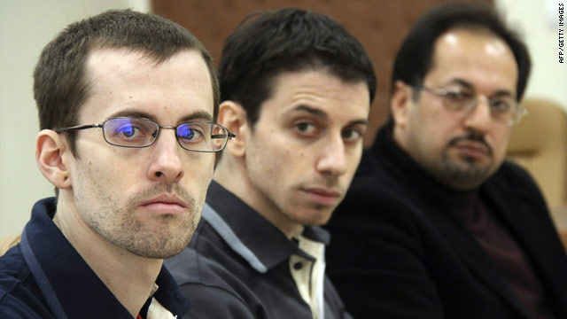 Shane Bauer, left, and Josh Fattal, center, sit with an unidentified interpreter in Tehran on February 6.