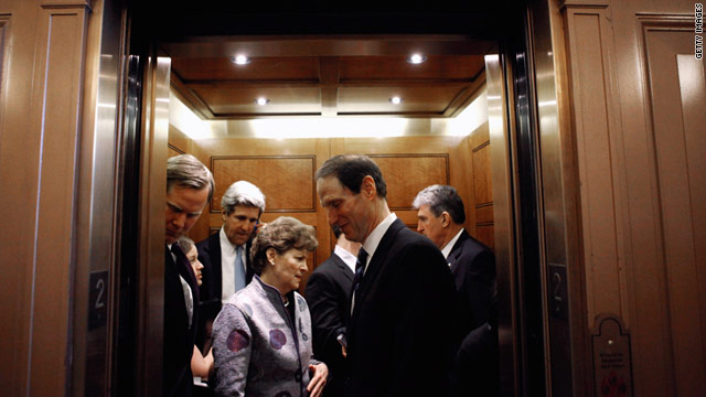 Senate Democrats crowd into an elevator after the Senate passed a two-week stopgap spending bill in early March.