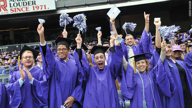 New York University students celebrate graduation on May 18 at Yankee Stadium.