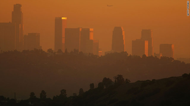 Smog obscures downtown Los Angeles in the evening.