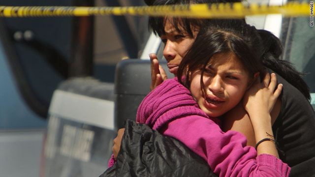 Relatives react to killings in Ciudad Juarez, Mexico. It has one of world's highest murder rates, a result of drug cartel turf wars.