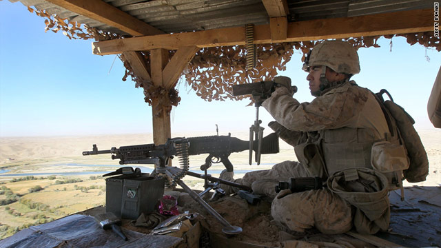 A U.S. Marine stands watch on October 22, 2010, in Kajaki, Afghanistan.