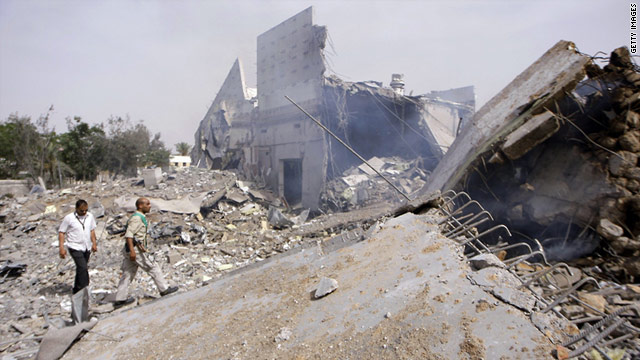 Libyans take journalists on a guided tour of destroyed buildings where Moammar Gadhafi had his base in Tripoli.
