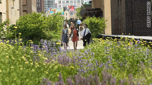 Visitors explore the newly opened second section of New York's High Line park.