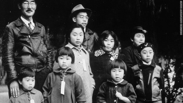 The Japanese-American Mochida family await relocation to a an internment camp in this photo taken by Dorothea Lange.