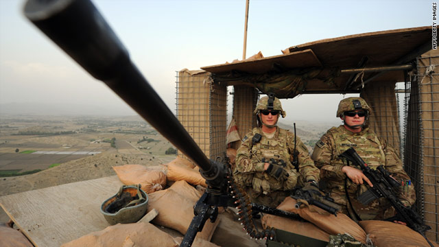 U.S. soldiers stand guard overlooking villages in Afghanistan's Khost province on Tuesday.