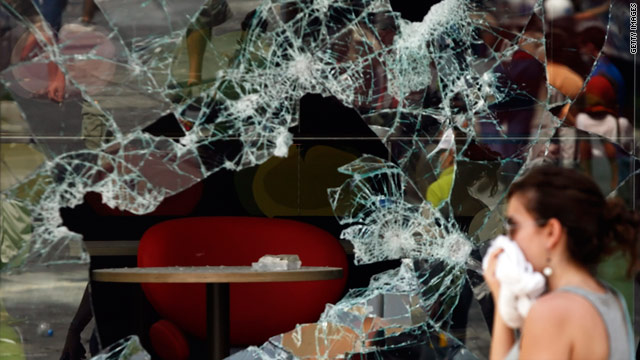 The push for austerity measures has led to clashes between police and protesters in Athens, leaving a trail of shattered glass.