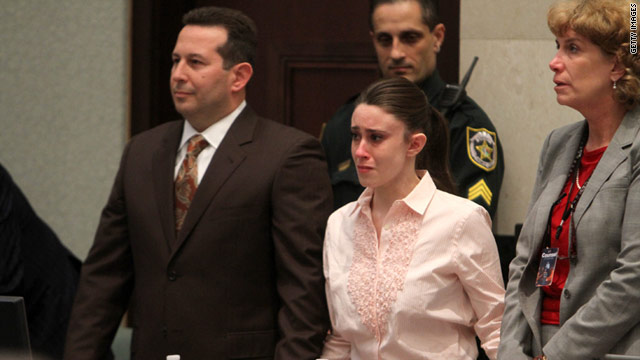 Casey Anthony, with her attorneys Jose Baez, left, and Dorothy Clay Sims, hears she has been acquitted.