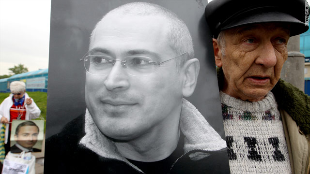 A supporter of Mikhail Khodorkovsky, imprisoned in Russia for eight years, holds his portrait outside a court in Moscow recently.