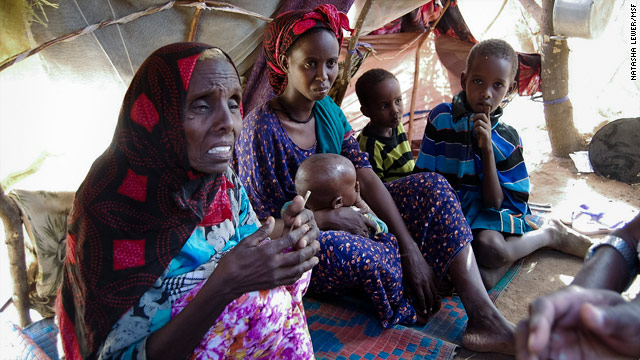 Fatima Mohammed Nur and her daughter-in-law and grandchildren left Somalia and are living in a makeshift shelter in Kenya.