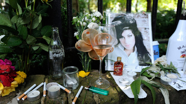 Cigarettes, alcohol and flowers are among the items left in front of Amy Winehouse's London home, where her body was found.