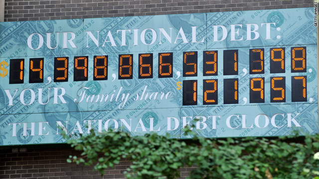 Numbers tick upward on the National Debt Clock on Sixth Avenue in New York on July 26, as the August 2 deadline nears.