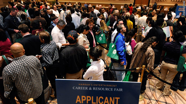 Applicants gather at a jobs fair in Las Vegas. Christine Owens says there are five unemployed workers for every job opening.