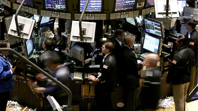 Traders do business on the floor of the New York Stock Exchange.