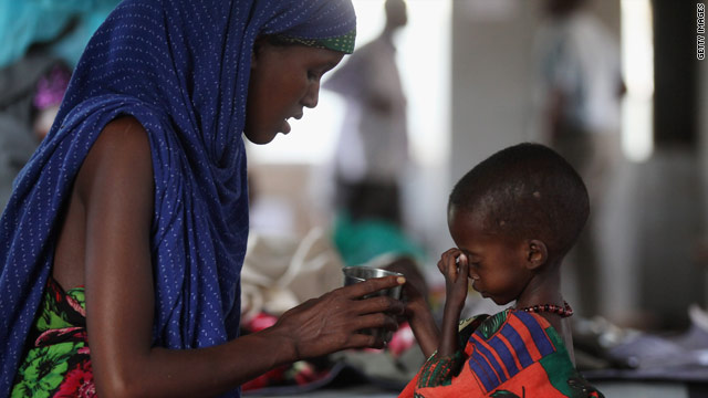 A refugee mother and child in a ward of the Medecins Sans Frontieres Hospital in the Dadaab refugee settlement on July 22.