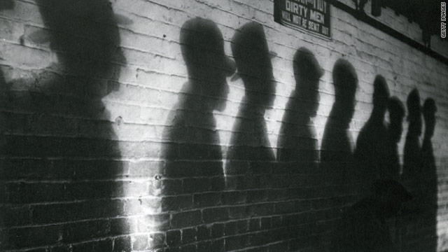 Shadows on a wall in 1930 Cincinnati, Ohio, belong to men in a bread line during the Great Depression.