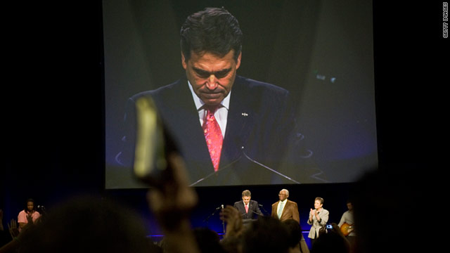 "Texas Gov. Rick Perry leads a prayer event  August 6 in Houston. Thousands prayed for God to save ""a nation in crisis."""