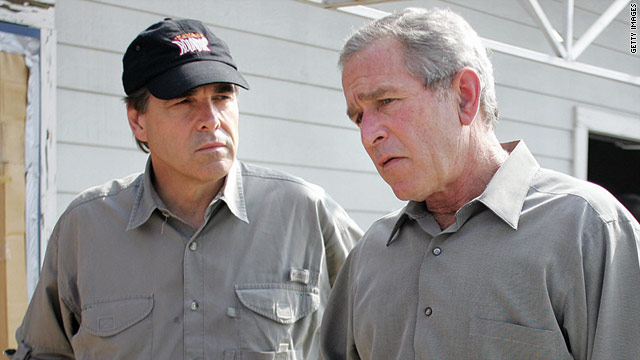 President George W. Bush addresses the press with Texas Gov. Rick Perry during a 2005 post-hurricane briefing in Beaumont.