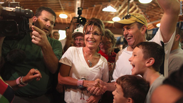 Former Alaska Governor Sarah Palin meets with fairgoers while visiting the Cattle Barn at the Iowa State Fair.