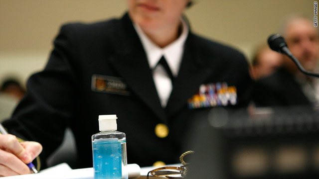 A bottle of hand sanitizer sits on a table as Rear Adm. Anne Schuchat testifies at a 2009 House panel hearing on the H1N1 virus.