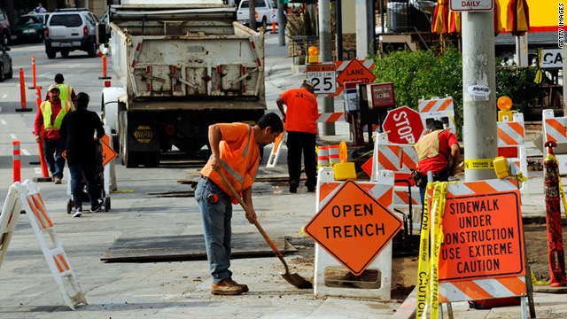 Workers repair the sidewalk in a Recovery Act project last year in Los Angeles.
