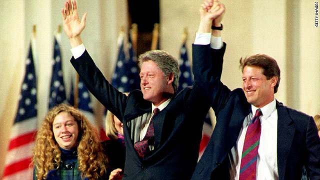 President-elect Bill Clinton and Vice President-elect Al Gore salute the crowd on November 3, 1992, in Little Rock, Arkansas.