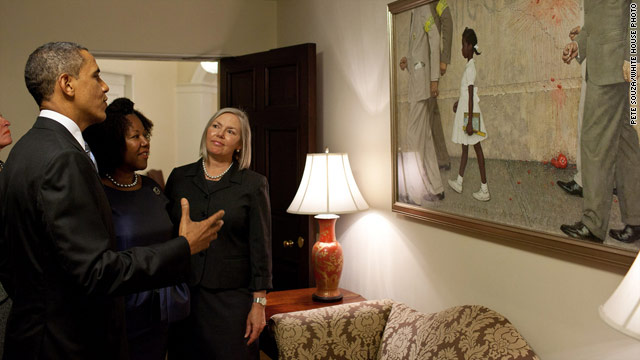 "President Obama, Ruby Bridges and representatives from the Norman Rockwell Museum look at ""The Problem We All Live With."""