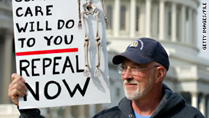 A demonstrator at a rally in Washington in November carries a sign calling for repeal of health care legislation.