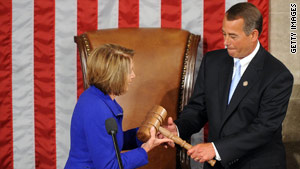 Outgoing House Speaker Nancy Pelosi hands the gavel over to new House Speaker John Boehner.