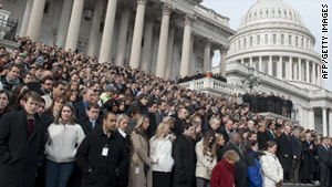A crowd, including members of Congress and staff, pauses for a moment of silence to honor the Arizona shooting victims.