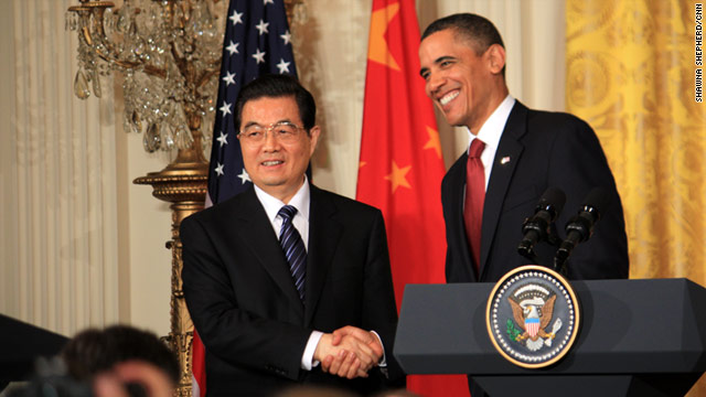 Chinese President Hu Jintao shakes hands with President Barack Obama. They represent the world's two largest economies.
