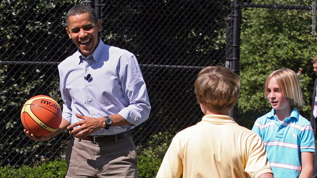 In this file photo, President Obama plays basketball with children at the White House in April.