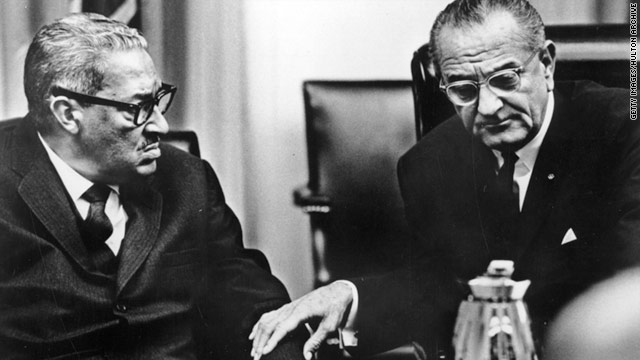Justice Thurgood Marshall, left, speaks with President Lyndon Johnson in August 1967.
