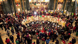 Protesters pack the rotunda of the Wisconsin Capitol in Madison on Wednesday.