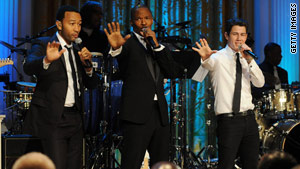 From left: Singers John Legend, Jamie Foxx and Nick Jonas sang Motown hits at the White House on Thursday night.