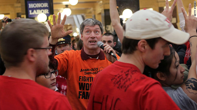 Wisconsin state Rep. Brett Hulsey, a Madison Democrat, encourages demonstrators to leave the Capitol rotunda Sunday.