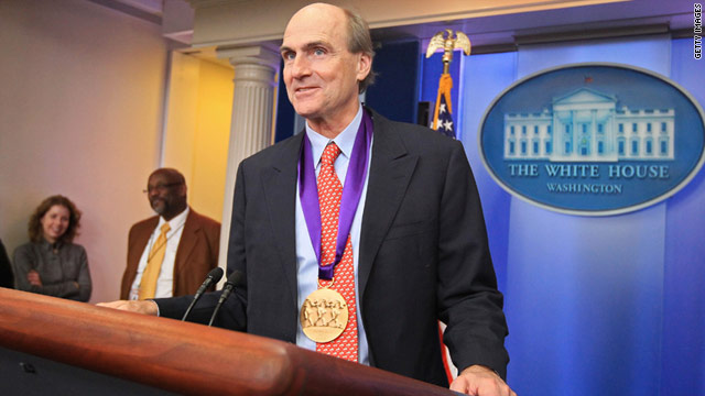 Musician James Taylor receives the National Medal of Arts and National Humanities Medal on Wednesday.