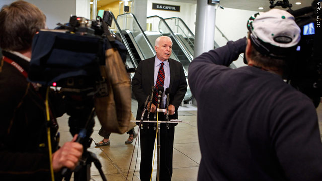 Sen. John McCain talks with reporters after a closed committee meeting with the Pentagon on Libya.