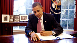 President Barack Obama signs a stopgap measure to avert a government shutdown March 2.