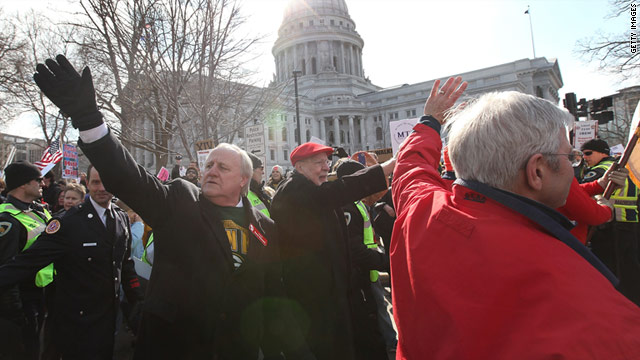 Democratic state senators greet supporters as they march around the Capitol with protesters on Saturday in Madison.