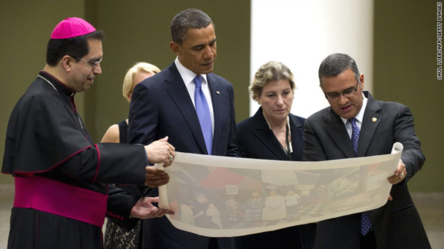 President Obama, seen touring a cathedral in El Salvador on Tuesday, cut his trip to Latin America short.