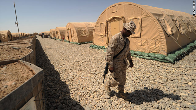 A U.S. Marine walks between tents at Forward Operating Base Delaram in southern Afghanistan on April 4.