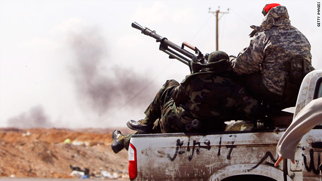 Libyan rebels under fire withdraw from the western edge of Ajdabiyah on April 8, 2011.