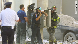 A New York City police officer uses a pay phone on September 11, 2001, after the terrorist attacks.