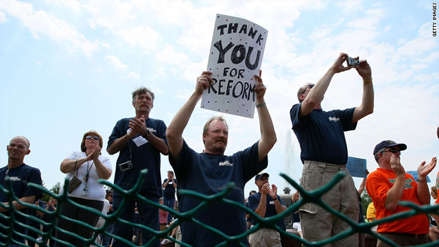 A union member holds a sign thanking Congress for healthcare reform during a May 6 rally in Washington.