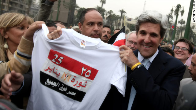 Sen. John Kerry, D-Massachusetts, holds up a T-shirt during his visit to Cairo's Tahrir Square on March 20.