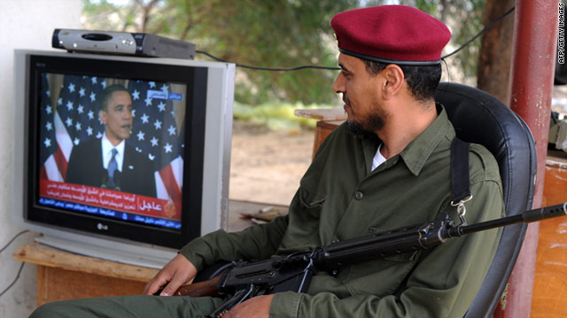 A rebel listens to President Obama's speech on TV while guarding an oil terminal in the Libyan town of Zuwaytinah on Thursday.