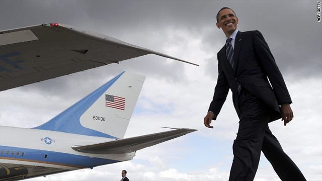 Barack Obama walks on the tarmac while changing Air Force One Boeing 757 to 747 at Orly airport near Paris on Friday.